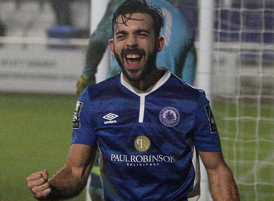 Midweek win moves Town top