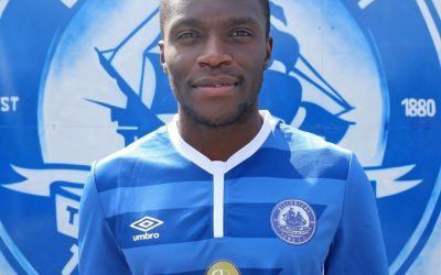 Moses joins Town