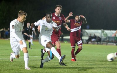 Moses goal earns a point for 10-man Town