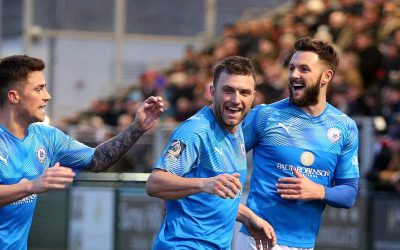 Town share points in 8 goal thriller